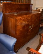 An Art Deco amboyna and mahogany crossbanded Cocktail cabinet/bar, 130cm by 50cm, 126cm high. Some