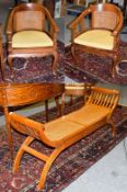 A pair of modern teak tub chairs with cane work panel 60cm by 56cm, 88cm high, seats 44cm high,