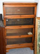 A Globe Wernicke mahogany four-tier bookcase, labelled, 87cm by 27cm by 142cm high . Good condition.