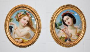 A pair of gilt framed reverse paintings on glass, portraits of maidens with fruit, 53cm by 44cm (2)