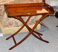 A butlers tray table on folding stand. Good condition. Makers Kennedy of Ipswich.