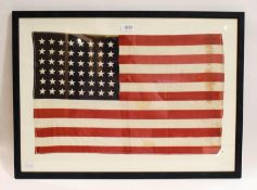 A stitched linen flag for the United States of America, 48 stars, 35cm by 57cm, (framed)
