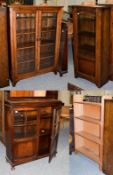 A pine glazed bookcase, 100cm by 31cm by 140cm high together with two similar 1940's oak bookcases