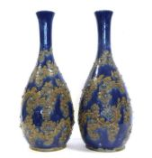 George Tinworth (1843-1913) for Doulton Lambeth: A Large Pair of Stoneware Vases, with applied