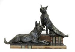 After Louis-Albert Carvin (French, 1875-1951): Bonne Garde, An Art Deco Spelter Group, modelled as