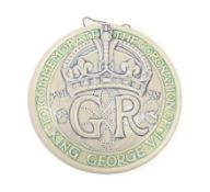 A Pilkington's Royal Lancastrian Circular Wall Plaque, designed by William S Mycock, entitled TO