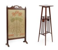 An Art Nouveau Inlaid Mahogany Plant Stand, the square top inlaid to each corner, above a railed