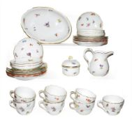 A quantity of Meissen porcelain tea wares painted with scattered sprigs and three similar tea