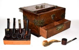 An early 20th century Smokers cabinet and later pipes