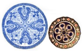 A Royal Crown Derby Imari plate, 23cm diameter and a Japanese blue and white dish, 31cm diameter (