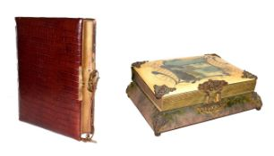 An Edwardian musical photograph album (empty) mounted in crocodile skin, together with a similar