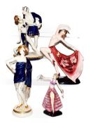 An Austrian Art Deco figure of a dancing girl stamped Keramos, two Royal Dux figures and another