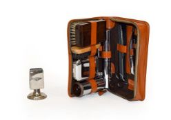 Bentley Interest: A Circa 1940/50 Brown Leather Motorist's Travelling Grooming Set, with zip opening