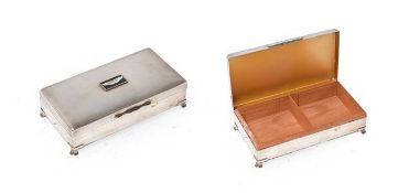 A Silver Plated Desktop Cigarette Box, the lid with engine turned decoration and an Aston Martin