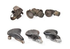 ~ Three Early 20th Century Carbide Bicycle Lamps; and Three Vintage Leather Motorcycle Seats,