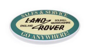 An Illuminated Car Display Sign: Land Rover Sales and Service Go Anywhere!, with low voltage