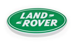 An Illuminated Car Display Sign: Land-Rover, with low voltage transformer, 58cm diameter