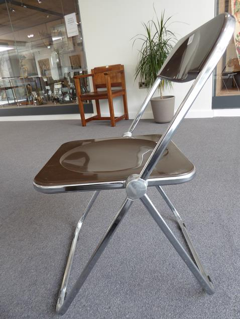 A Platone Folding Table, designed by Giancarlo Piretti, brown moulded perspex, on chrome steel base, - Image 18 of 28