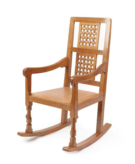 Workshop of Robert Mouseman Thompson (Kilburn): An English Oak Rocking Chair, with two lattice panel