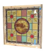 An Arts & Crafts Stained Glass Panel, the central roundel painted with a swallow and butterfly,