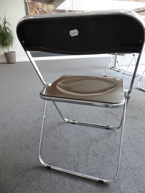 A Platone Folding Table, designed by Giancarlo Piretti, brown moulded perspex, on chrome steel base, - Image 25 of 28
