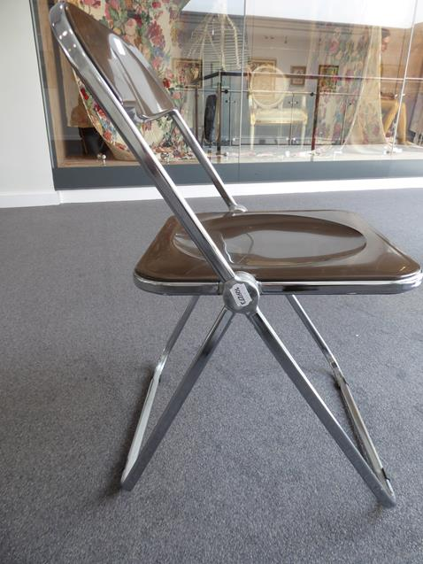 A Platone Folding Table, designed by Giancarlo Piretti, brown moulded perspex, on chrome steel base, - Image 17 of 28