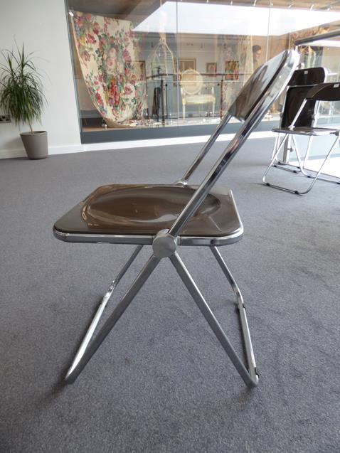 A Platone Folding Table, designed by Giancarlo Piretti, brown moulded perspex, on chrome steel base, - Image 27 of 28