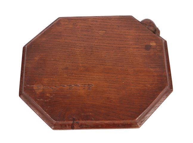 Robert Mouseman Thompson (1876-1955): An English Oak Bread Board, of canted rectangular shape,
