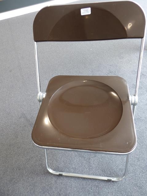 A Platone Folding Table, designed by Giancarlo Piretti, brown moulded perspex, on chrome steel base, - Image 15 of 28