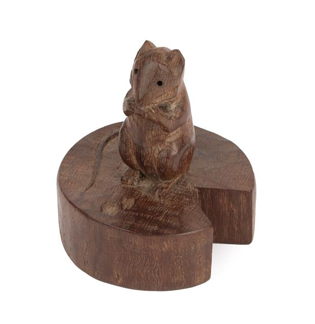 Robert Mouseman Thompson (1876-1955): An English Oak Mouse on a Wedge, the mouse carved on it's