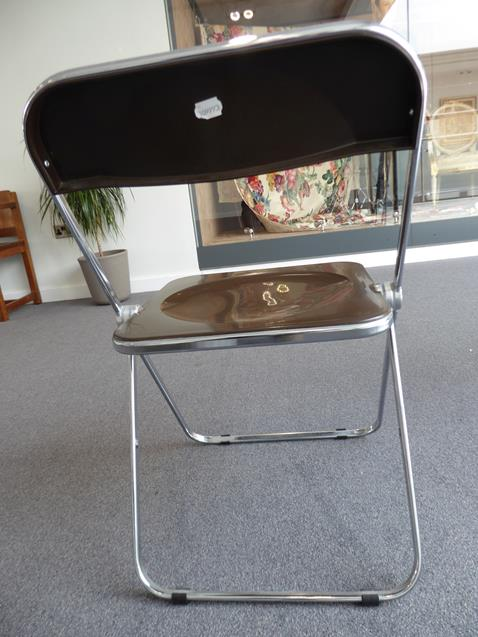 A Platone Folding Table, designed by Giancarlo Piretti, brown moulded perspex, on chrome steel base, - Image 16 of 28