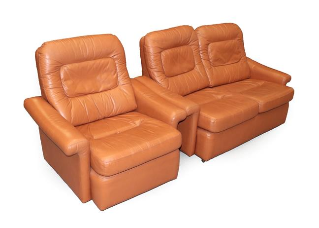 A Tetrad Brown Leather Sofa and Armchair, on brown castors, both labelled tetrad ENGLAND MAKERS OF