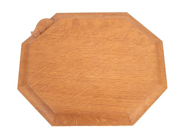 Workshop of Robert Mouseman Thompson (Kilburn): An English Oak Bread Board, c.1970's, of canted