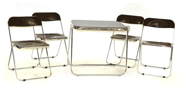 A Platone Folding Table, designed by Giancarlo Piretti, brown moulded perspex, on chrome steel base,