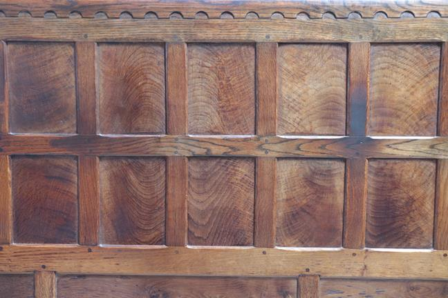 Robert Mouseman Thompson (1876-1955): An English Oak 5ft Panelled Bedstead, penny moulded top,