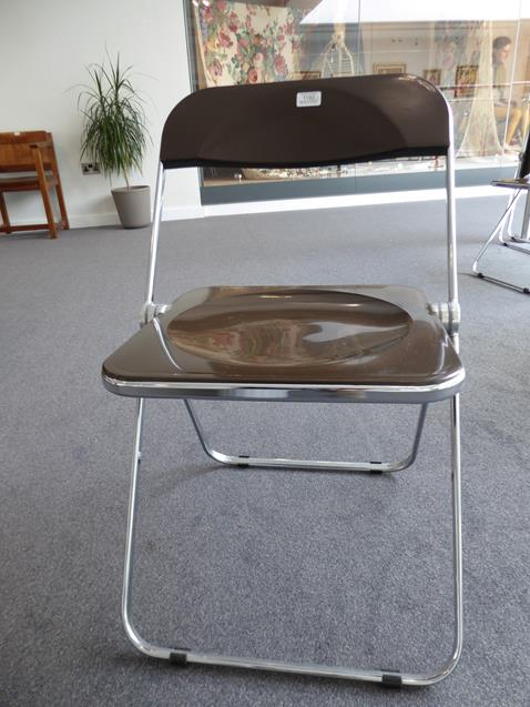 A Platone Folding Table, designed by Giancarlo Piretti, brown moulded perspex, on chrome steel base, - Image 24 of 28