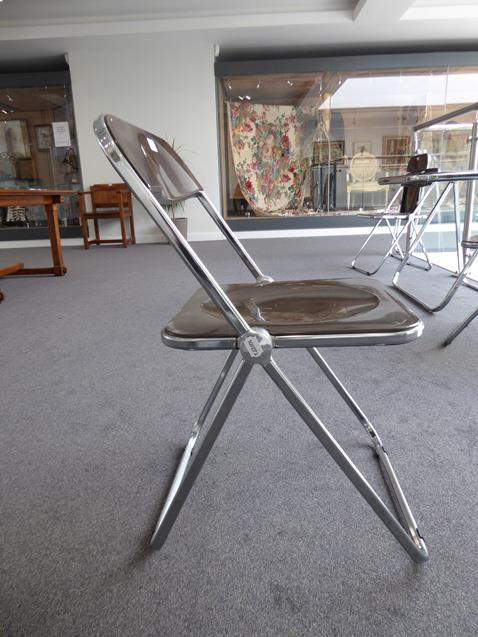 A Platone Folding Table, designed by Giancarlo Piretti, brown moulded perspex, on chrome steel base, - Image 22 of 28