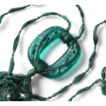 René Lalique (French, 1860-1945): An Emerald Glass Lezards Pendant, No.1648, moulded with lizards,