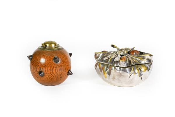 Two Novelty Inkwells, one modelled as a sea mine, globular wood and with applied spikes, with hinged