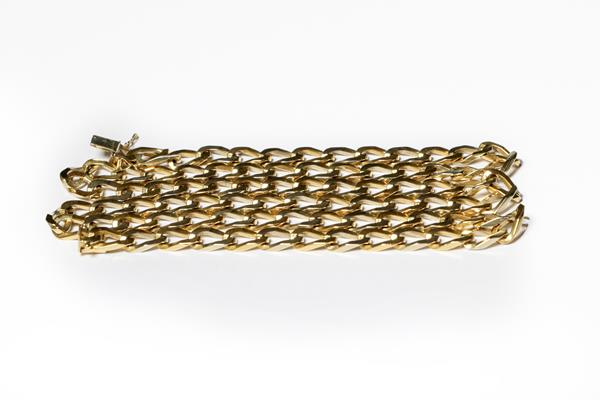 A flat curb link necklace, stamped '750', length 78cm . Stamped '750' and in our opinion would