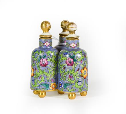 A Ceramic Three Section Scent-Bottle, each of the three bottles on ball feet, the sides painted with