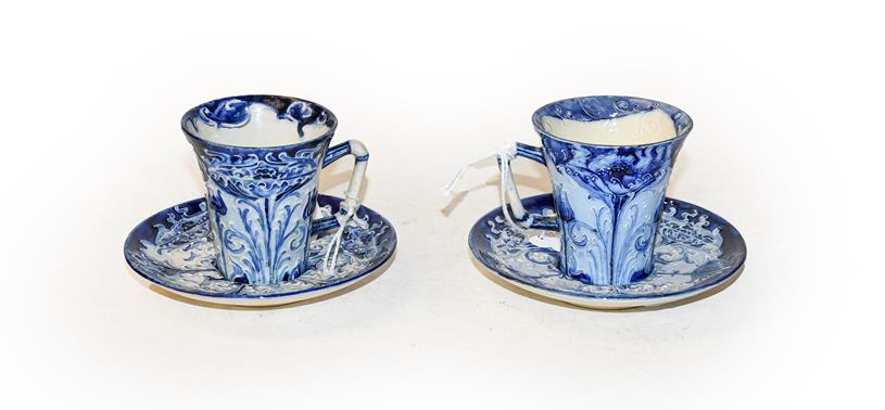 Two William Moorcroft Florian ware blue and white cups and saucers