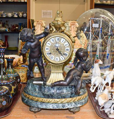 A 19th century style gilt metal, marble striking mantel clock