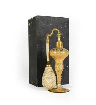 A Gilt-Metal Mounted Gilt Glass Atomiser bottle, baluster and on spreading foot, in cardboard box,