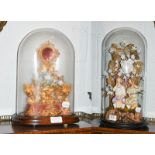 A pair of Victorian bisque figures under glass dome, together with a pocket watch stand under