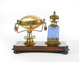 A Gilt-Metal Mounted Blue-Glass Scent-Bottle, mounted on a wood base with a gilt-metal mounted shell