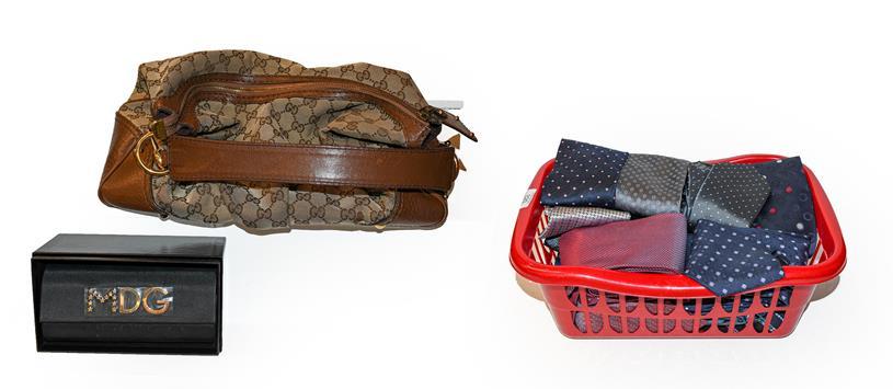 A Gucci handbag with original dust bag, a pair of Dolce & Gabbana sunglasses with original boxes,