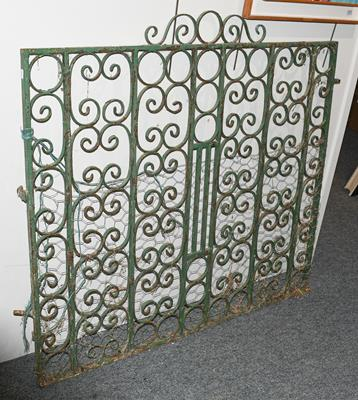 A Victorian green painted wrought iron gate decorated with scroll work, 122cm by 115cm