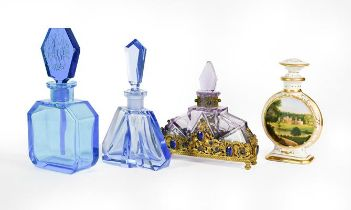 Three Glass Scent-Bottles, two in blue, the third amethyst glass and with 'gem'-set gilt-metal