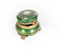 A Gilt-Metal and Enamel Box, bombe circular, overall enameled in green and decorated with putto